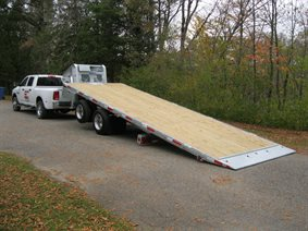 Sliding axle trailer
